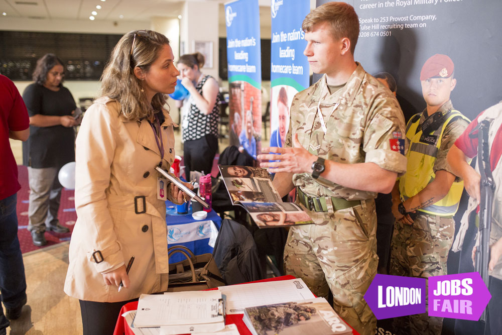 The British Army stand at the jobs fair meeting jobseekers