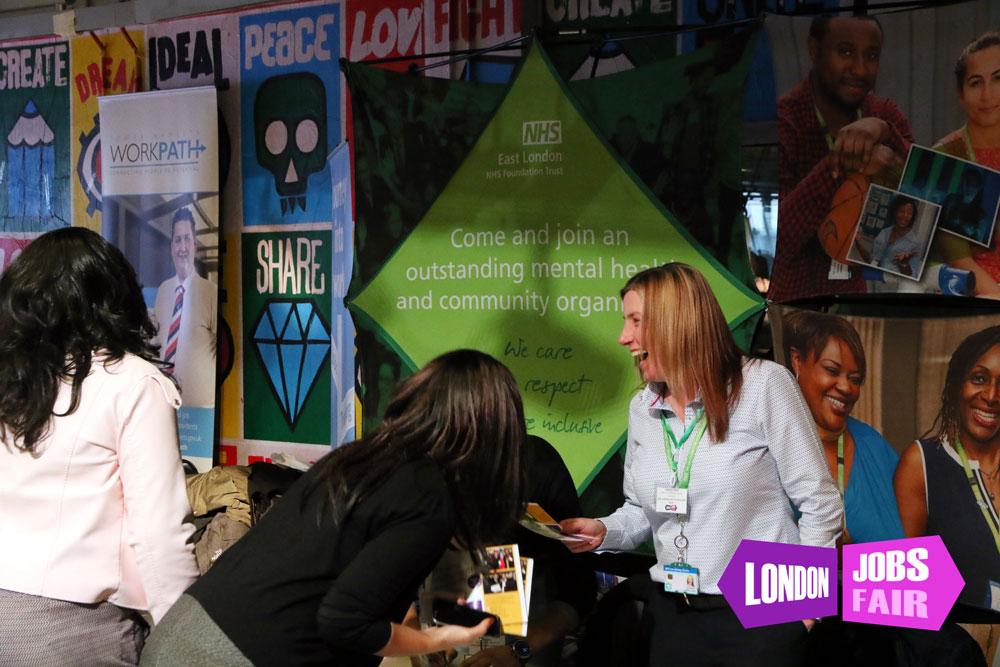 NHS East London stand at the jobs fair meeting jobseekers