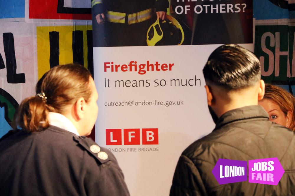 London Fire Brigade stand at the jobs fair meeting jobseekers