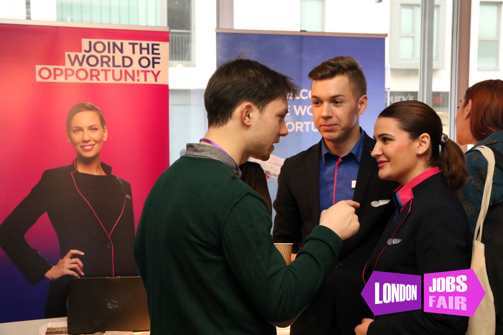 A stand at the jobs fair meeting jobseekers