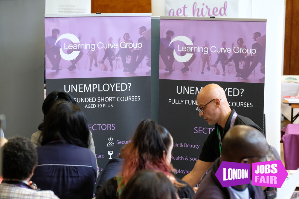 Learning Curve Group stand at the jobs fair meeting jobseekers
