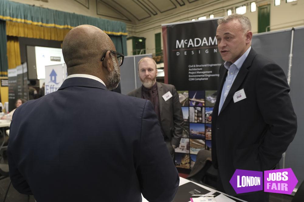 McAdam Design stand at the Tower Hamlets jobs fair talking to Cllr Uz Zaman