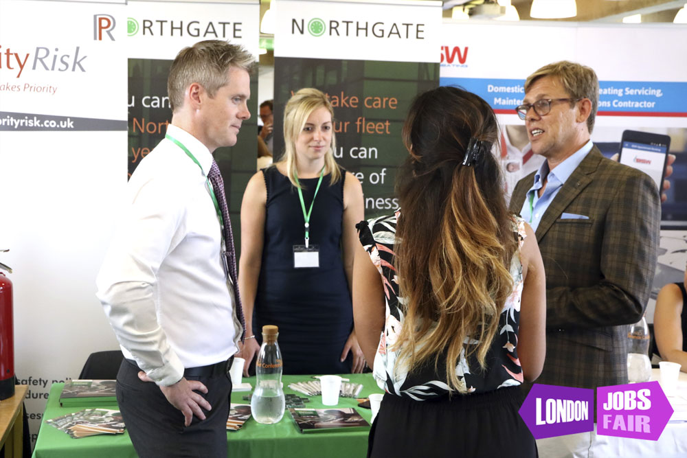 Northgate stand at london jobs fair talking to jobseekers