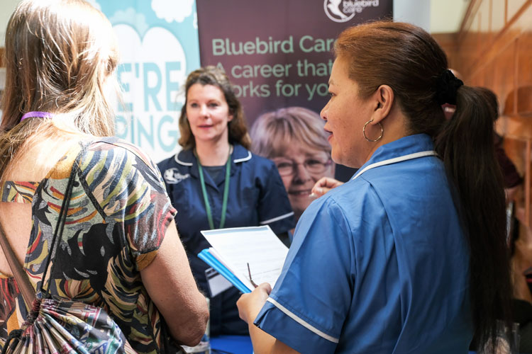 Bluebird Care stand at the jobs fair meeting jobseekers