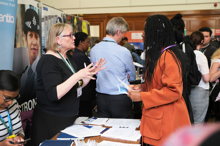 London Transport Police stand at the jobs fair meeting jobseekers